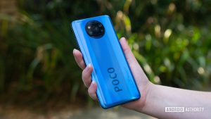 Xiaomi-Poco-X3-NFC-held-in-the-hand-outside-to-show-off-the-rear-side-1200x675